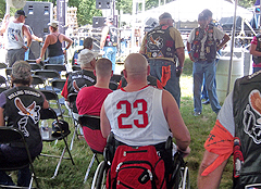(Above) Wounded warriors take a break from the heat under the tent. (Below) Carney ready and waiting to feed the wounded warriors